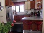 kitchen with american fridge and Siemens Equipment