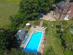 aerial view of pool and owners cottage