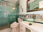 Spectacular en-suite Master bath! Lavishly renovated in an ultra-modern style with glass tile, glass serenity by-pass...