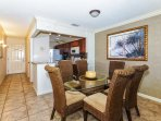 Dining room is right off the kitchen with seating for six