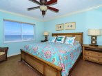 Master bedroom with bay window overlooking the Gulf and beach below. King-size bed with large HDTV