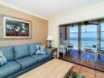 Spacious living room with view out to Lanai, the beach and azure waters of the Gulf of Mexico...large HDTV, stereo, and...