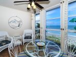 Enclosed, air conditioned lanai has an amazing view of the Gulf and the beach below - dining table is placed on the...