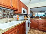 Modern, renovated, fully equipped kitchen with granite counters, glass tile backs splash...