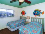 3rd bedroom with two twin-size beds, HDTV, large window overlooking the bay and boat docks