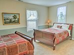 Four can share this spacious bedroom housing 2 queen-sized beds.