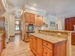 Large chef's kitchen with hardwood floors and and granite counter tops
