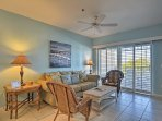 Soothing shades of blue and beach-themed decor adorn the living area.