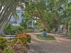 Lush landscaping guides you through the Olde Marco Island Inn & Suites community.