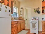 The quaint kitchen is equipped to suit all of your cooking needs!