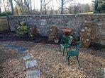 Private, partially walled south facing rear garden