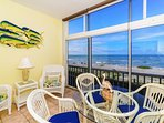 Enclosed, air conditioned lanai has an amazing view of the Gulf and the beach below - spectacular views.