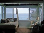 View from lanai with double bed and seating area.