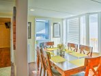 Home-cooked meals are waiting to be served at the dining table with seating for 6.