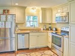 It will be easy to pack a beachfront picnic in this fully equipped kitchen.