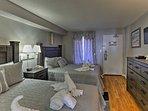The cozy bedroom features 2 queen beds.