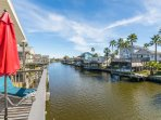 Charming home on the canal w/ shared pool, an outdoor fire & bay views