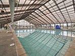 Swim laps in the indoor pool.