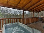 After a day hiking mountain trails, look forward to soaking in the private hot tub on the covered and secluded deck.