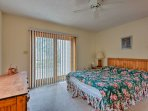 The master bedroom has access to the back porch and offers a cozy queen bed.