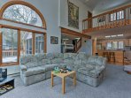 This expansive property offers 6 lucky guests a rustically furnished interior with 2 fireplaces, tall ceilings, and...