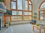 Gaze out through the windows to see the lush foliage surrounding the property.