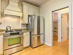 Stainless steel appliances and ample counterspace makes home-cooking a breeze.