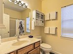 Each bathroom is stocked with complimentary toiletries and fresh towels.
