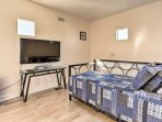 A twin daybed with twin trundle bed provides up to 2 guests with cozy sleeping accommodations.