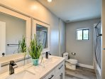 Utilize the his-and-hers vanity and shower/tub combo found in the third full bathroom.