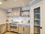 You're ensured ample counter space and storage space with the addition of a large pantry.
