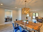 Enjoy good food with the family around the 6-person dining table.