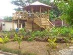 Pergola in just landscaped garden