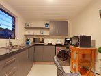 Fully equipped fitted kitchen with washing machine