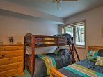 The second bedroom houses a twin-over-twin bunk bed and one full bed.