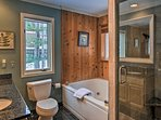 Rinse off in the walk-in shower or take a soothing soak in the tub.