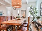 The rustic dining table with leather chairs and a fab light fixture