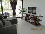Living room with smart TV and Wifi.