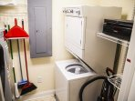 Utility room with stacked washer and dryer