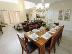 Dining Area for Eight (8) w/ Pool Access; Breakfast Bar Seating for Four (4)