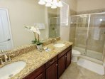 En-Suite Bath to Downstairs King Master w/Double Sinks, Walk In Shower & Pool Access