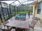 Screened In Pool & Spa Area w/Patio Seating; Access From Downstairs Living Area and Downstairs King Bedroom