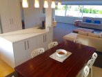 Lovely spacious and stylish dining area. Plenty of crockery, cutlery and all cooking utensils.