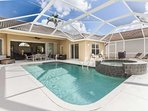 This expansive pool deck offers conversational seating space, dining area, as well as an area for sun lounging.