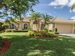 This fabulous vacation home has impeccably manicured grounds with inviting curb appeal.