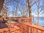Just steps from the shoreline, the deck has unobstructed lake views.