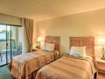This bedroom offers 2 cozy twin beds.
