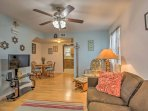Inside, the home features a classic interior with comfortable furnishings and homey decor.
