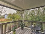 Relax on this porch while looking out on the yard.