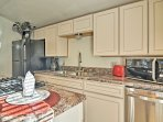 Complete with stainless steel appliances and granite countertops, the kitchen has everything you'll need and more.